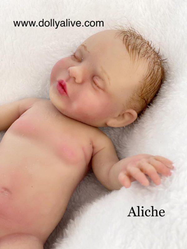 Bebés de silicona pintados dolly alive
